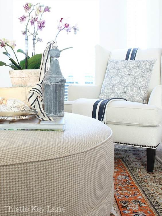 Valentine vignette on the ottoman with white chair and navy accents.