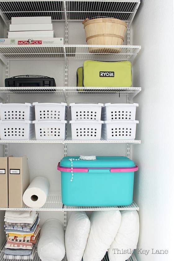 Closet with wire shelves, storage bins, and craft supplies.