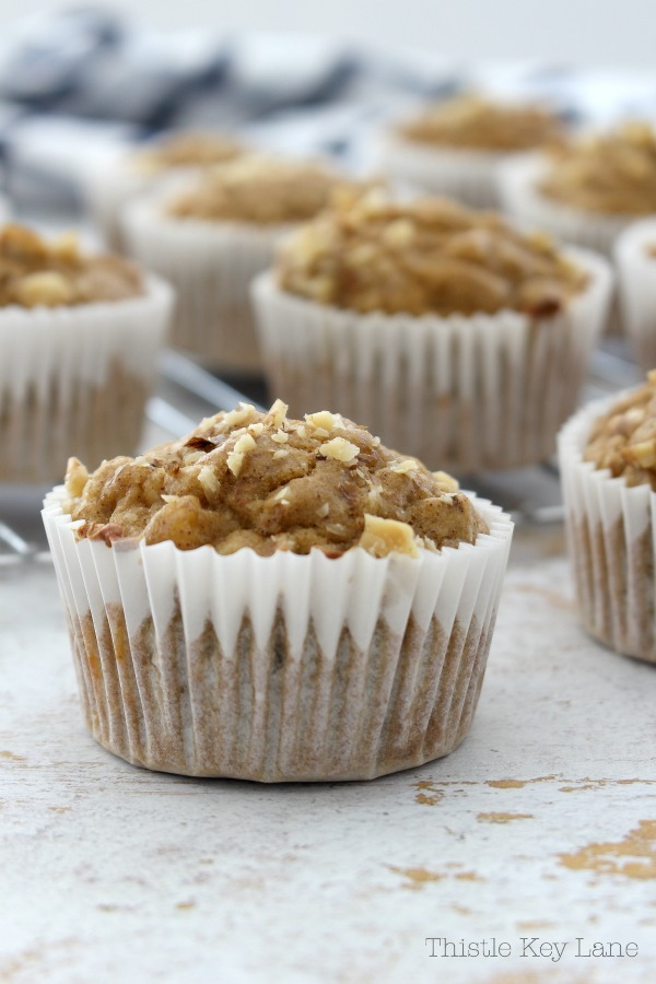 Banana Nut Muffins in white paper liners.