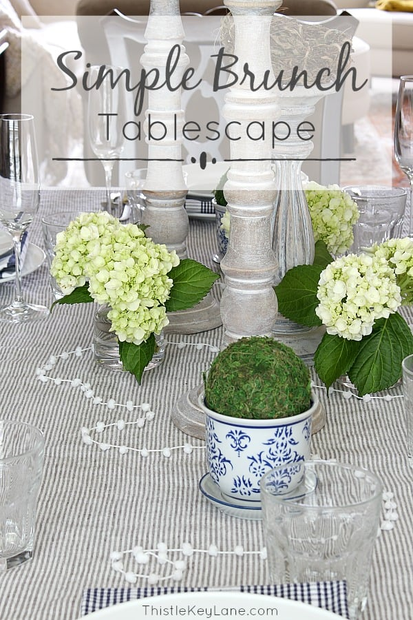 Simple brunch tablescape with country French accents in blue, white and green.