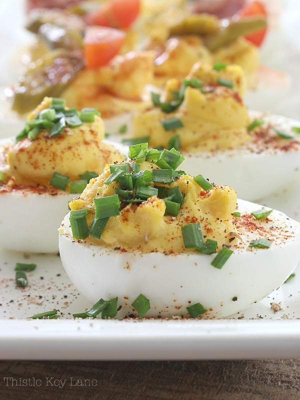 Deviled eggs with chives and paprika.