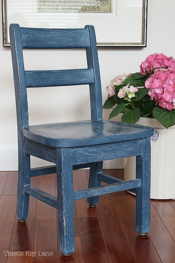 Painted blue chair with liming wax.