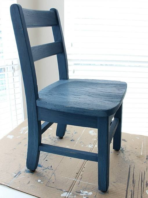 Wood chair painted blue.