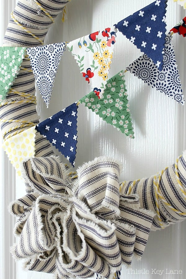 Close up look of ticking wreath with bunting.