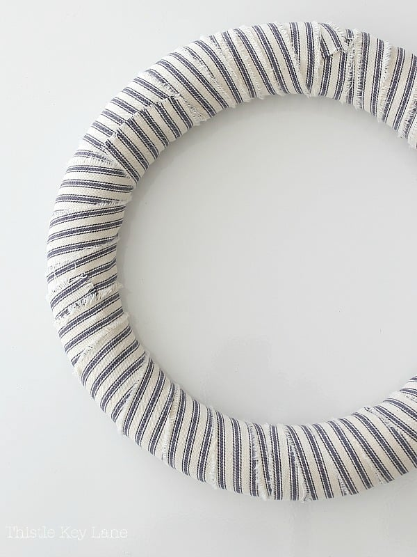 Ticking covered wreath form.