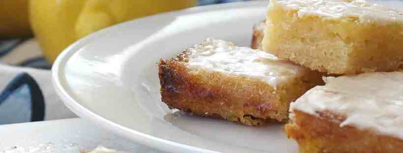 Lemon squares on a white plate