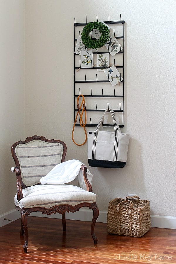 Cup rack used a coat rack in the entry with a French linen chair in the spring home tour