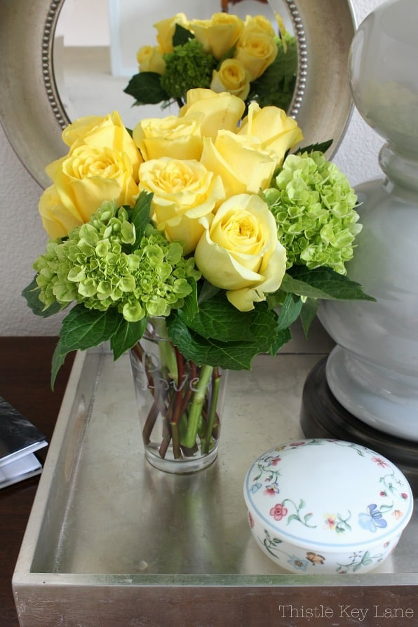 Arrangement of yellow roses on a silver tray