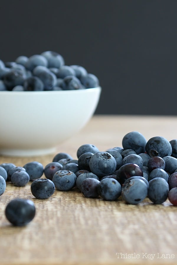 Fresh blueberries on the table and in a bowl.