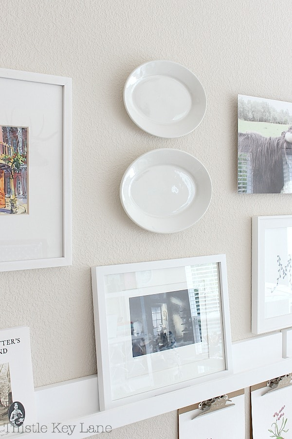 Decorating with plates on a gallery wall.