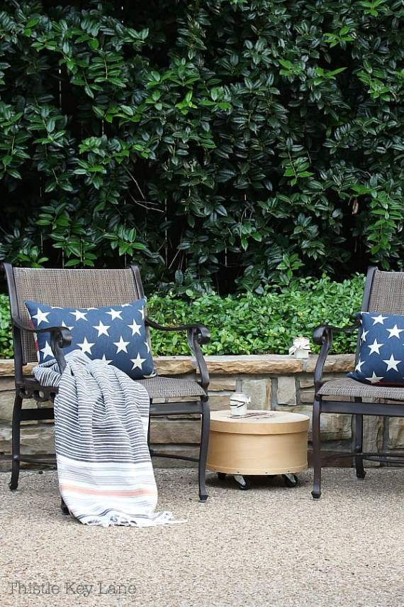 Summer ready patio and garden tour with metal chairs and pillows.