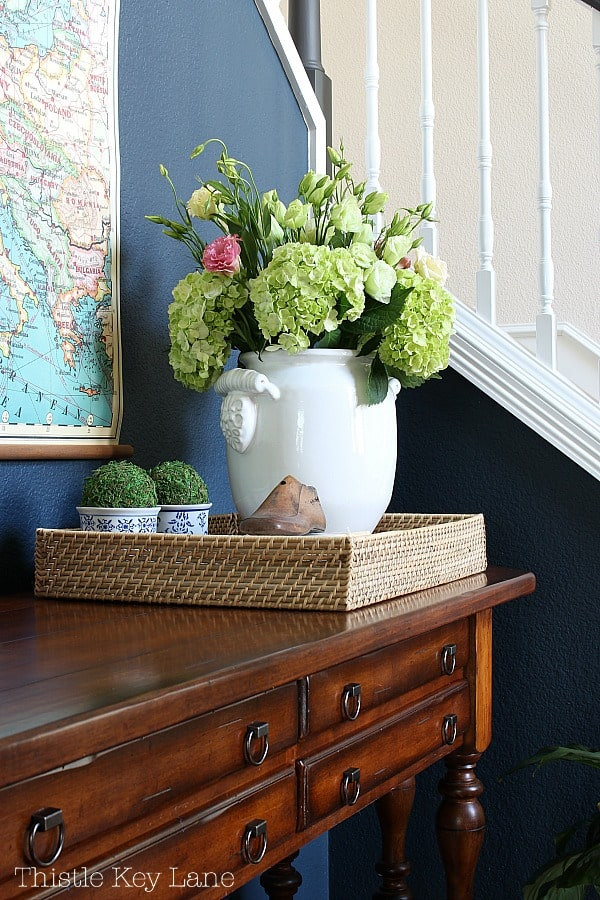 How to style an entry table tray with vintage items.