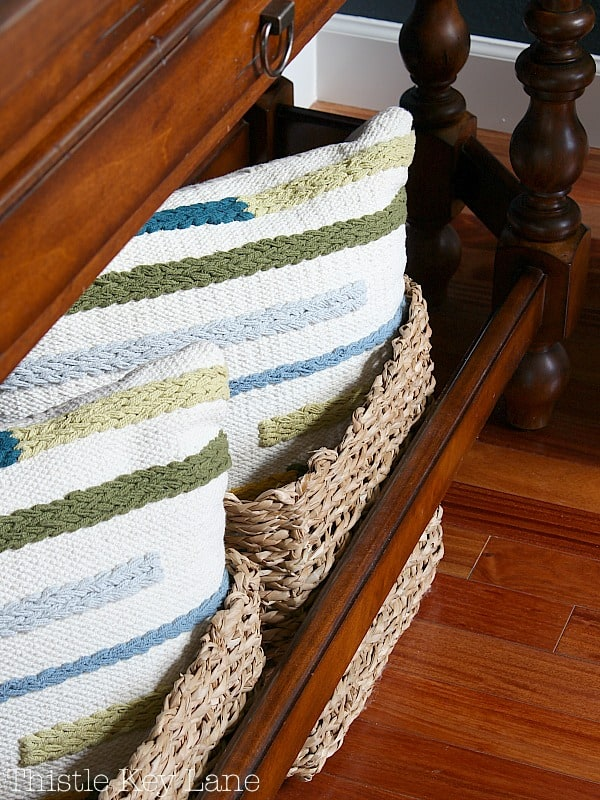 Pillows in baskets under the entry table.