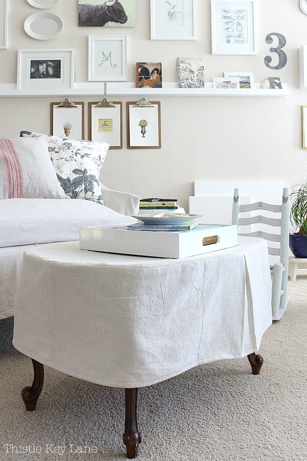 DIY slipcover for coffee table using a drop cloth.