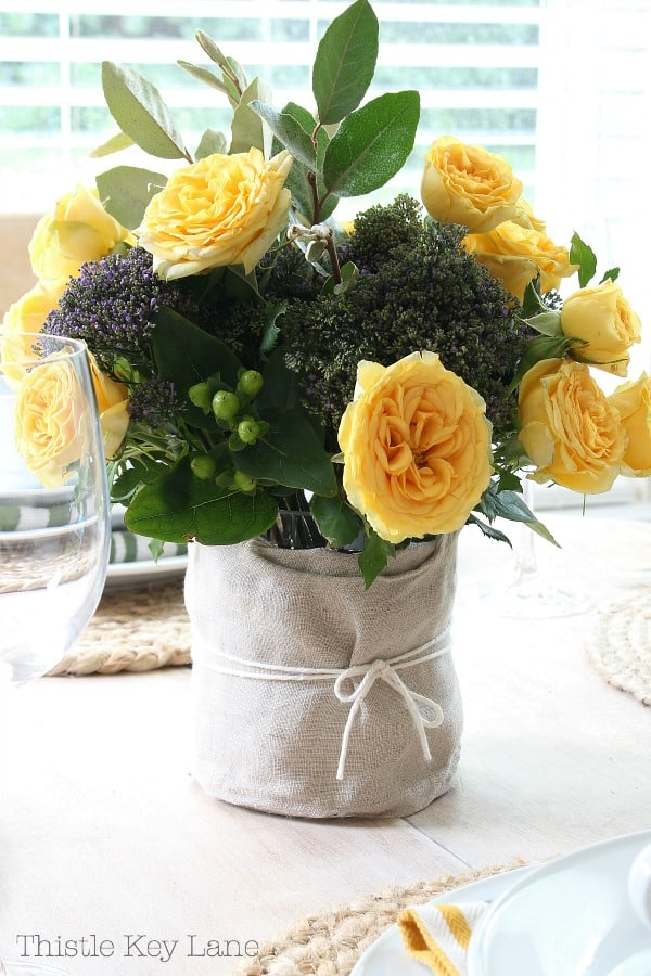 Easy fall tablescape with a yellow rose centerpiece.