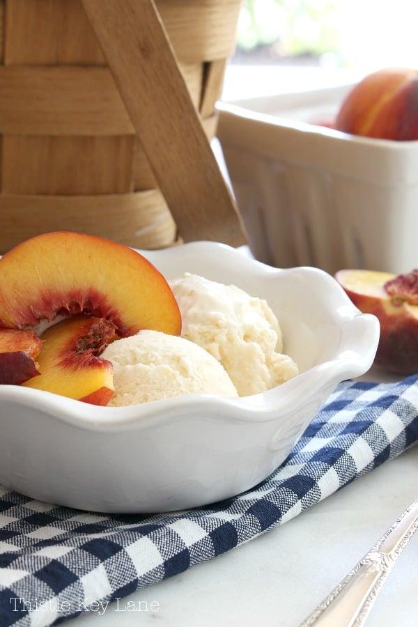 Sliced peaches on top of peach ice cream.