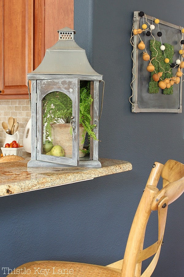 Transitioning Summer To Fall Kitchen Ideas with lanterns and plants.