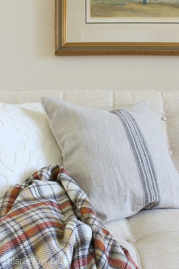 Simple Fall Home Decor Ideas - French grain sack pillow and a plaid throw.