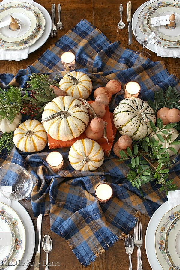Easy Thanksgiving Tablescape Using Gourds And Plaid for a centerpiece.