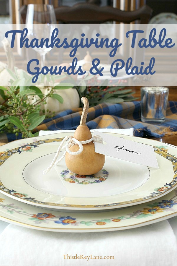 Easy Thanksgiving Tablescape Using Gourds And Plaid - Single gourd and place card on each plate.