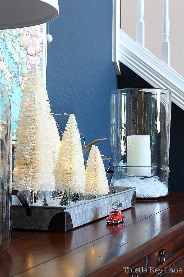 Simple Bottle Brush Christmas Tree Vignette With Fairy Lights