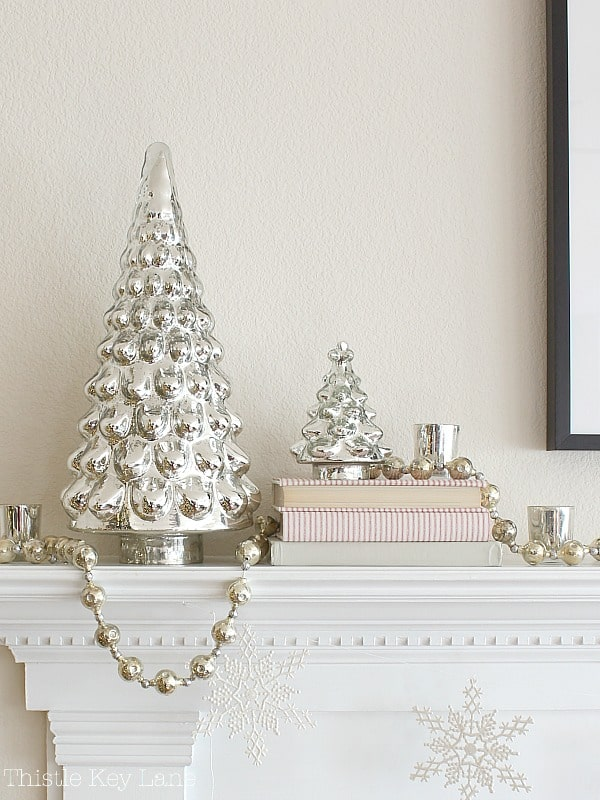Mercury glass trees and ticking for a vintage look.