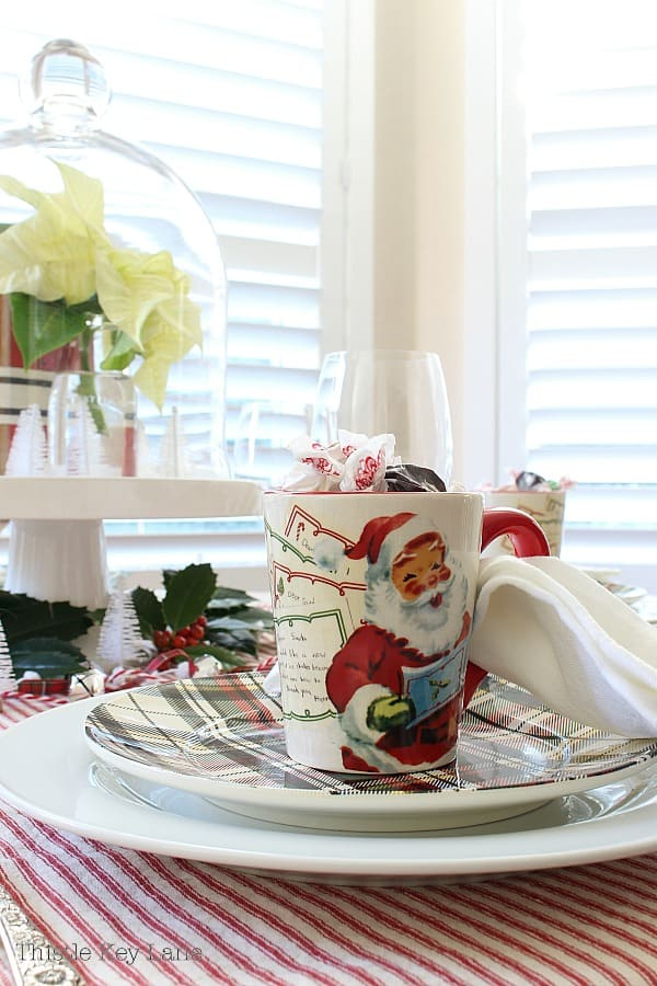 Vintage looking Santa cups with candy.