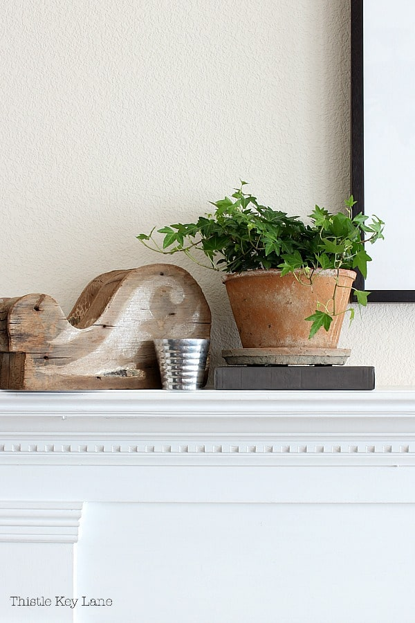 Early Spring Mantel Decorating Ideas With Rustic Corbel