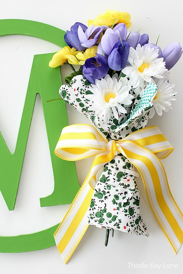 Flowers wrapped with gloves and ribbon.
