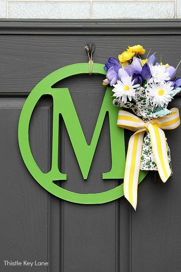 DIY Wreath With Garden Gloves and Flowers - dark gray door.