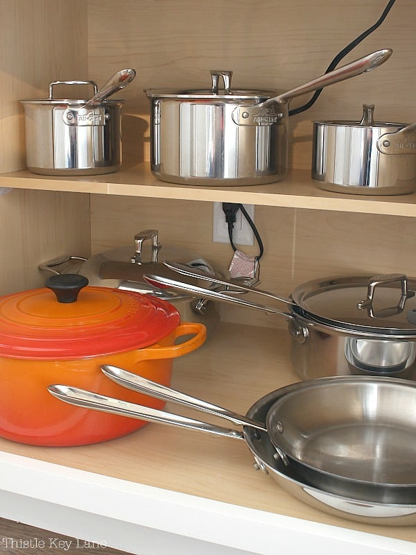 Easy Kitchen Organizing Tips for pots and pans.