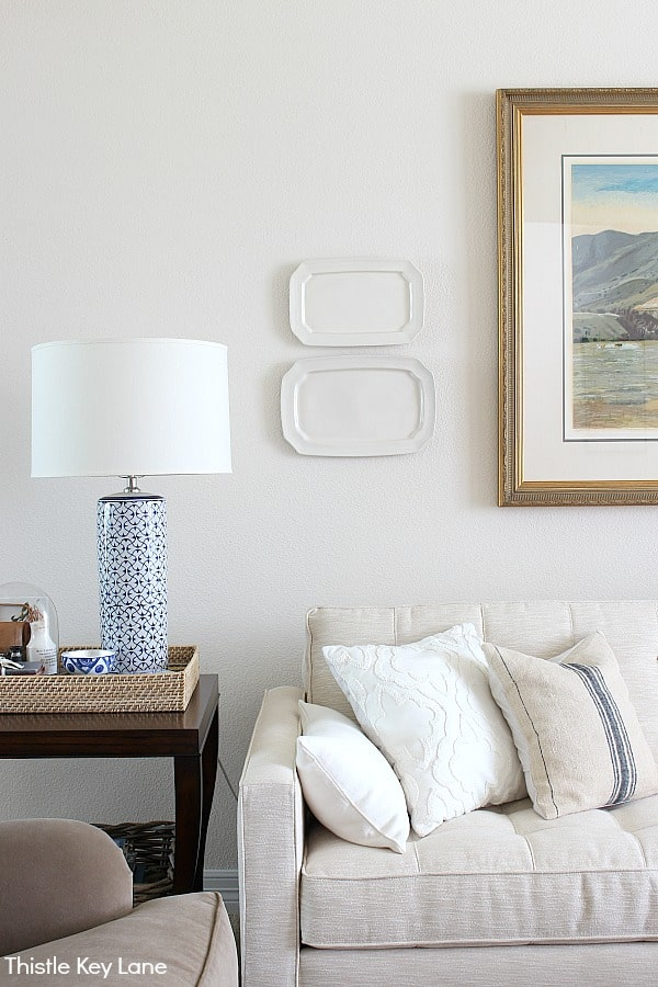 Ideas For Decorating With Plates - Ironstone platters over sofa.