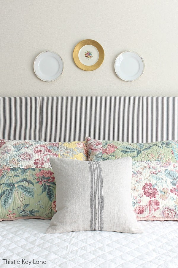 Ideas For Decorating With Plates - China plates over headboard and pillows.