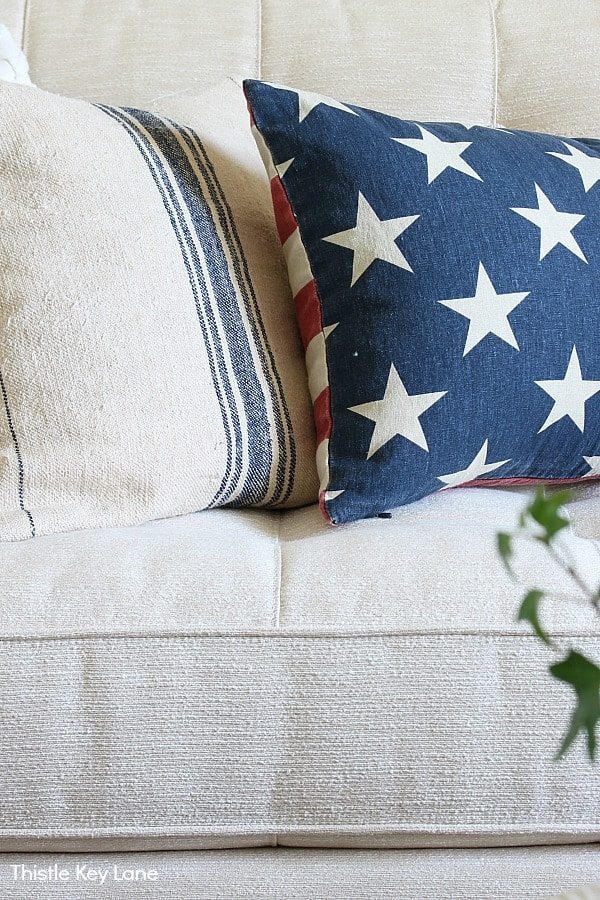 Vintage grain sack pillow with lumbar stars and stripes.
