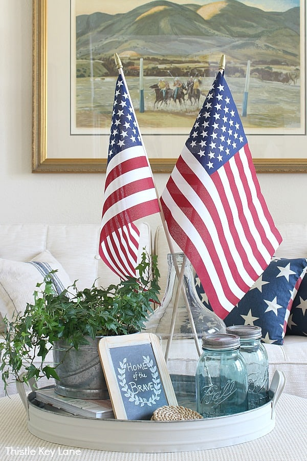 Create A Simple Patriotic Tray Vignette - American flags in a patriotic tray vignette with sofa in the background.