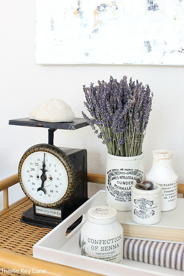 Vintage ironstone jars with dried lavender and a black scale.