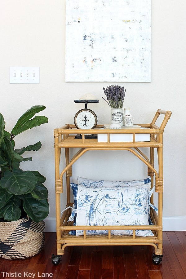 Styling A Bar Cart Three Ways - Displaying and ironstone collection and pillows.