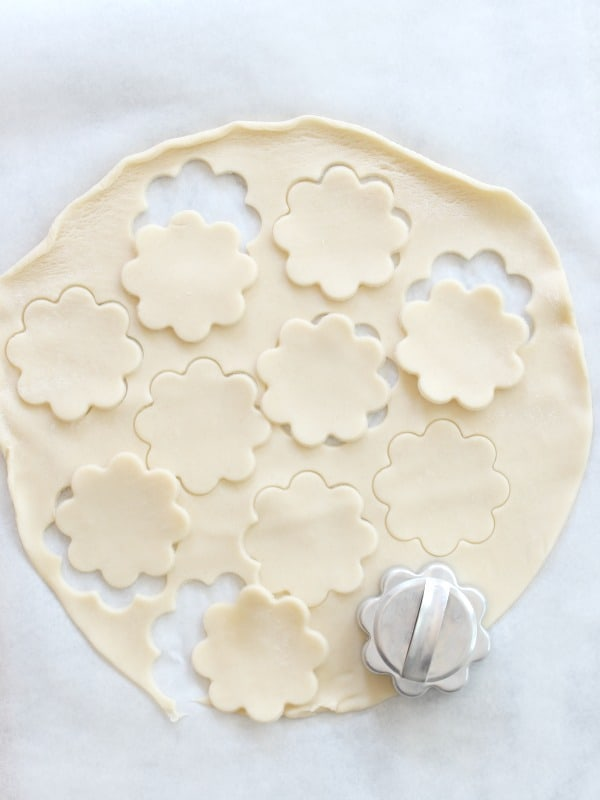 Cutting pie dough with a cookie cutter for cobbler crust.