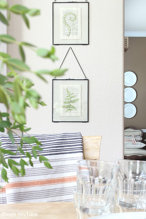 Glass floating frames with botanical watercolors.
