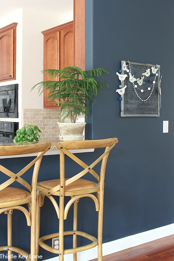 Chalkboard on navy wall with bird garland - Simple Summer Home Decorating Tour.