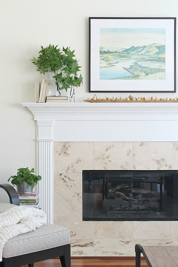 White mantel greenery, and brown gourds. Simple Fall Mantel With Gourds And Greenery