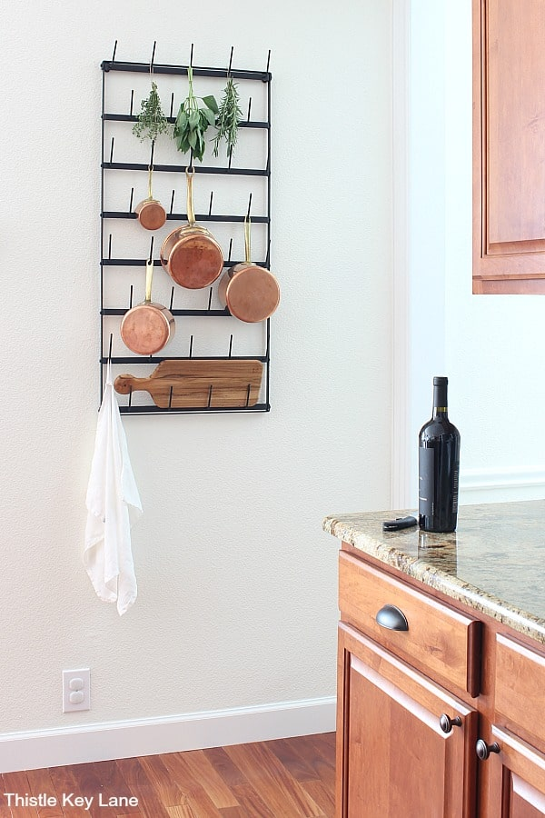 Metal wall rack with copper pots - Repurposing A Cup Rack For Pots.