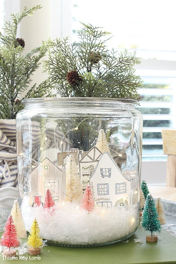 Fairy light, house cut outs and bottle brush trees. Snowy Village Houses In A Jar.