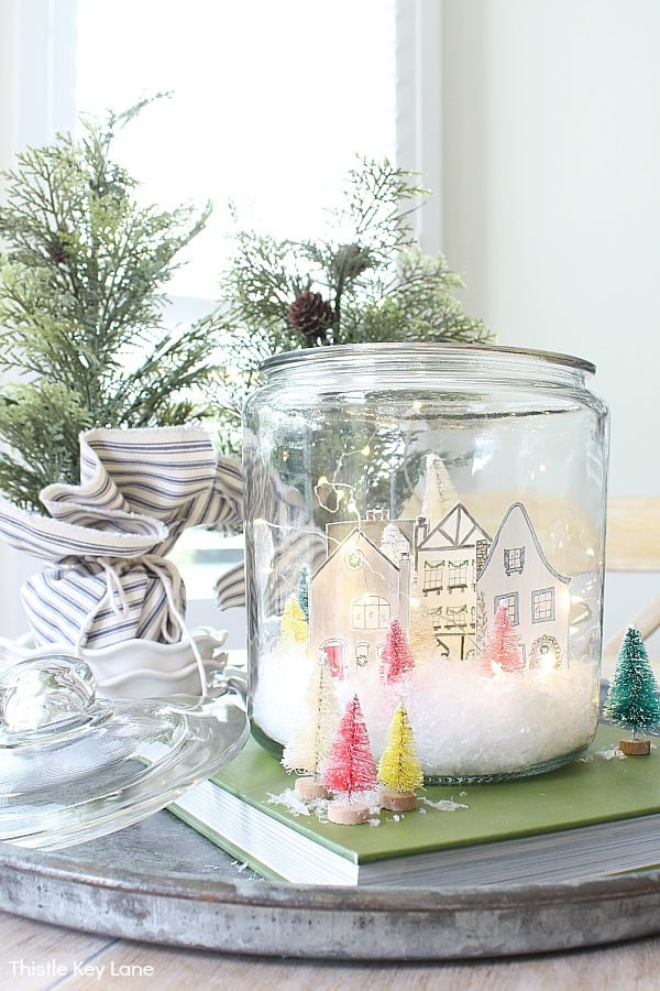 Snow scene in a jar with fairy lights. Snowy Village Houses In A Jar.