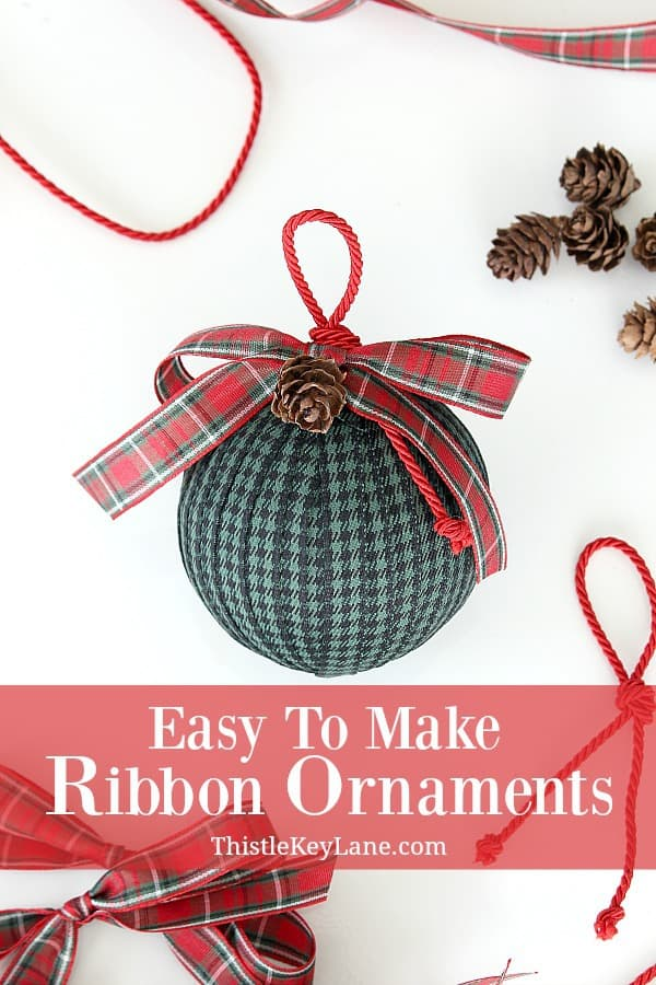 Black And Green Check Ornaments With Red Plaid Bow.