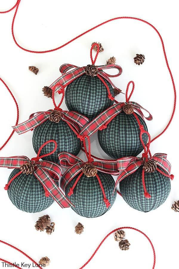 Green And Black Check Ribbon Ornaments With Red Plaid Bows.