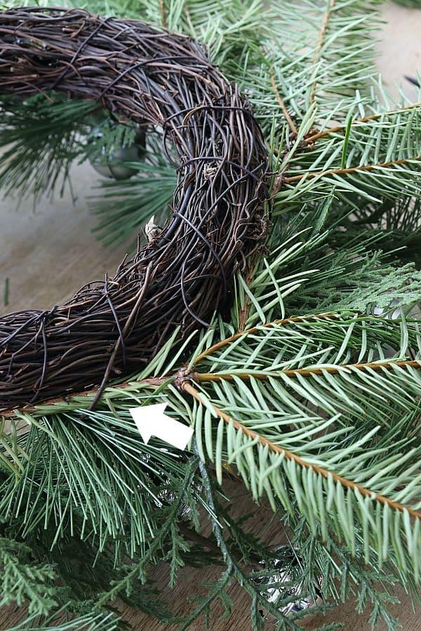 Add greenery to update a wreath.