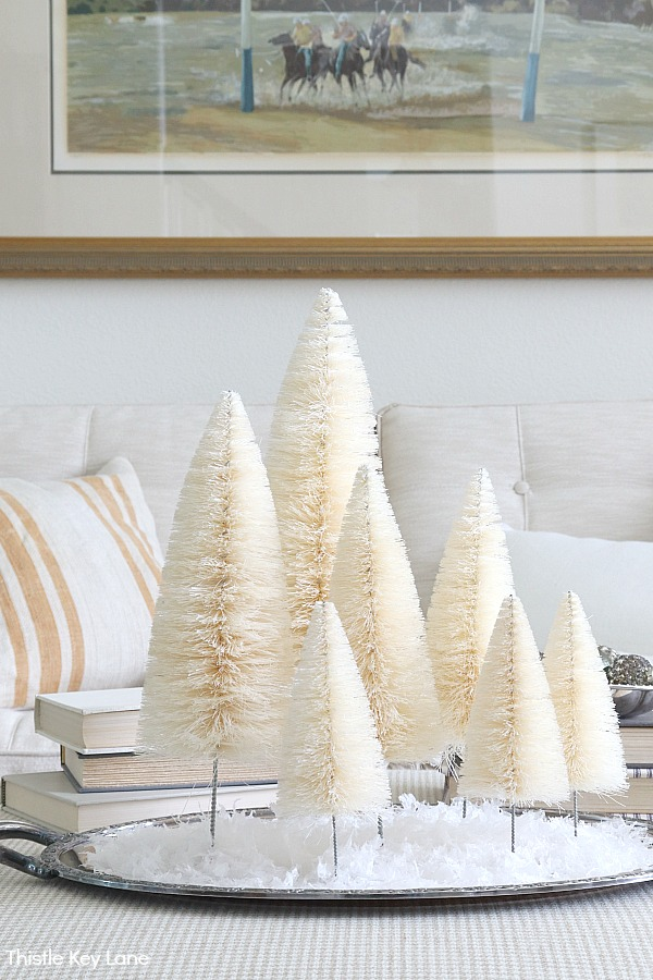 White bottle brush tree vignette on a silver tray.