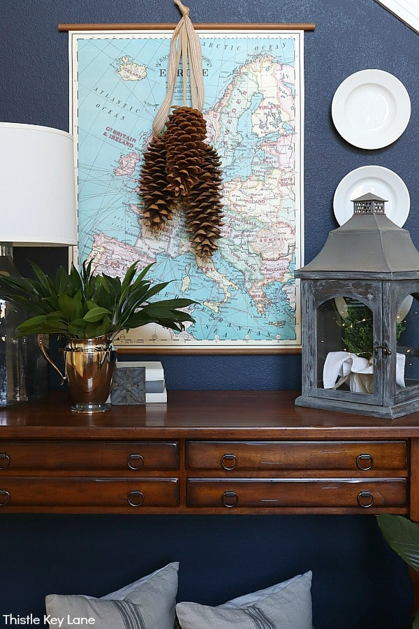 Map over entry table with a pinecone swag. Winter Entry Table And A Pinecone Swag.