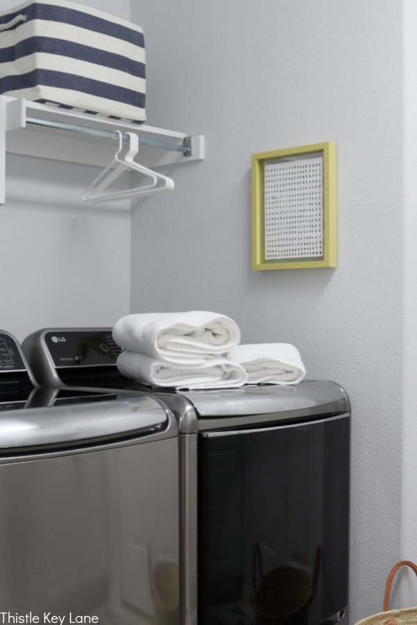 Washer and dryer with folded towels on top. Laundry Room Organizing Ideas.